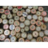 A collection of vintage wooden cotton reels to include Sylko, Chain, Coats, Clark & Co and Anchor,