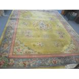 A good quality Chinese rug, bought at Harrods, traditional pattern, central dragon, floral motets