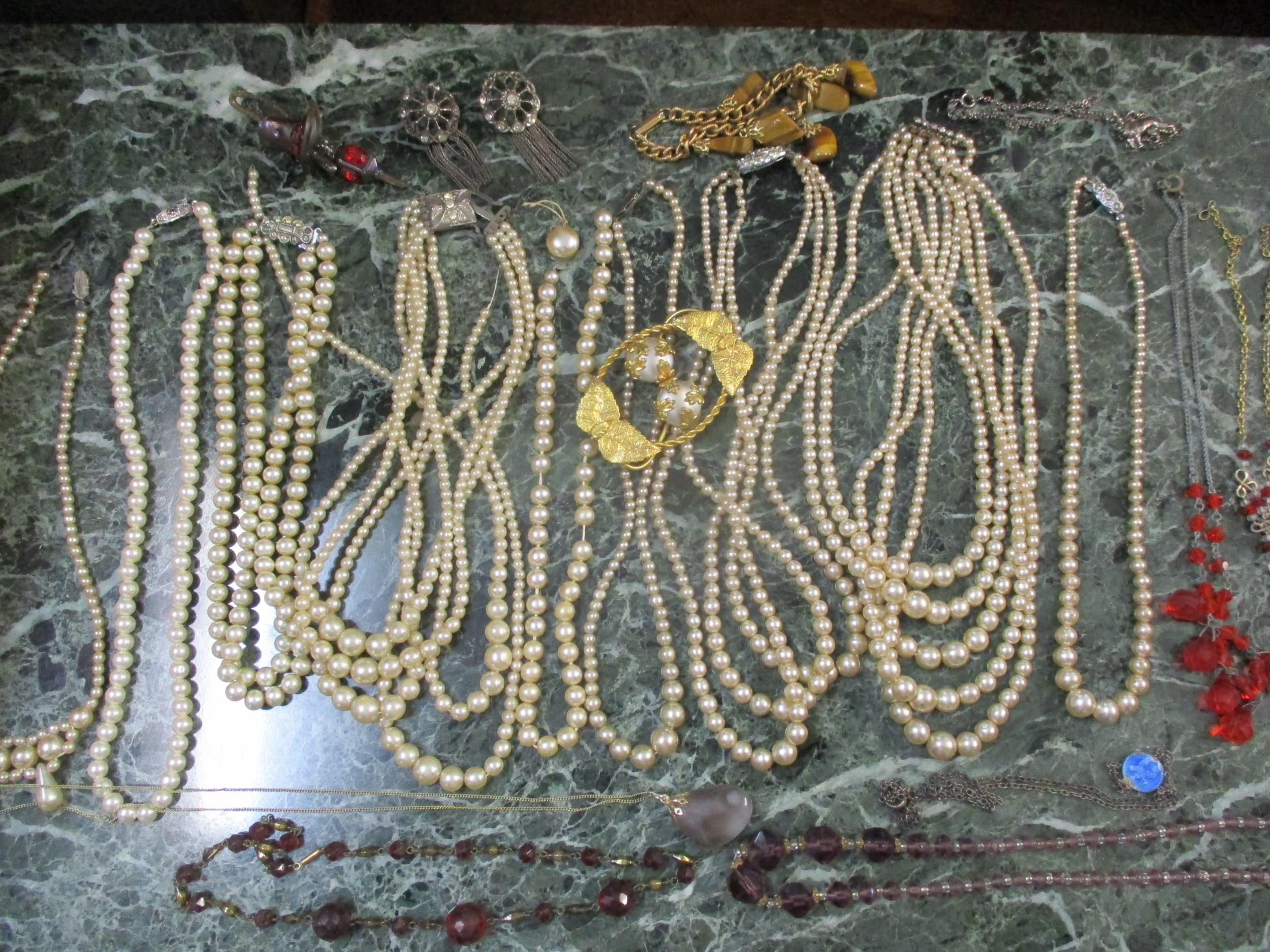 A small quantity of vintage costume jewellery to include multi-string pearl necklaces, A/F, a