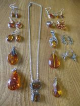 Mixed amber and silver earrings and pendants together with amber effect examples, a silver and amber