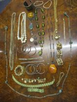A 1960's/70's vanity case housing mixed 20th Century costume jewellery to include silver items