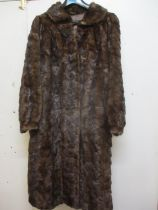 """A Saga Scandinavian brown mink coat, purchased from Greece in the 1980's, 40"""" chest x 42"""" long, with"""