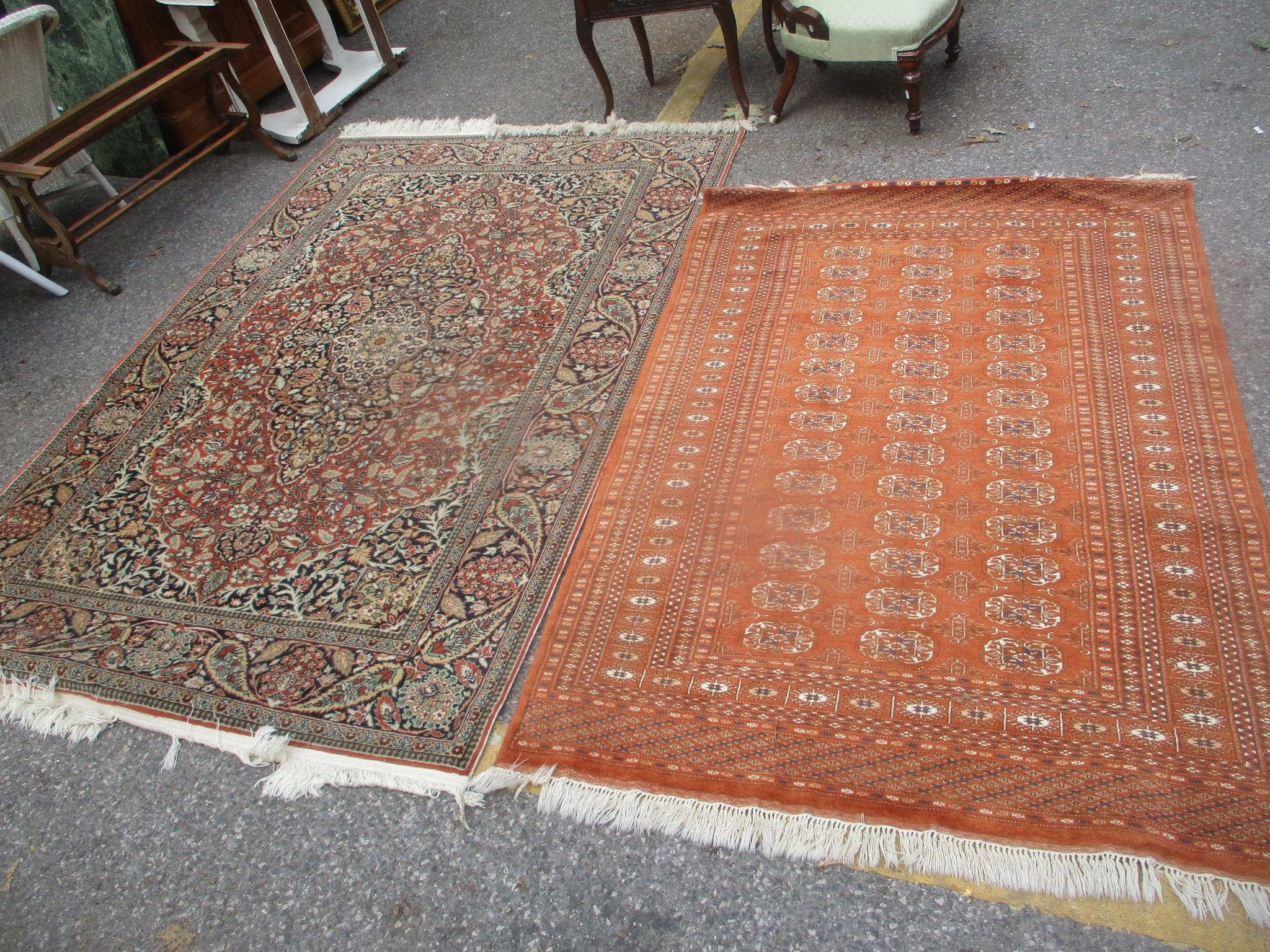 Two Turkish rugs to include a red ground elephant foot motif rug, 190 x 127cm and a floral rug