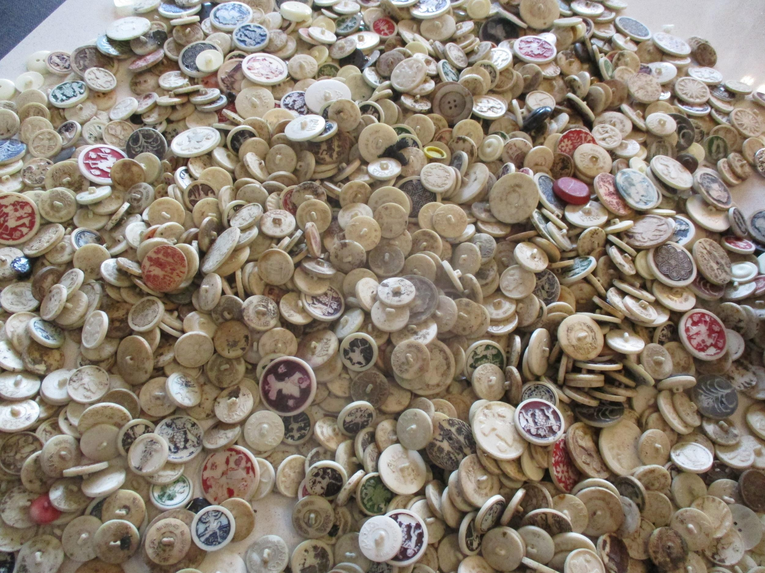 A large quantity of imperfect 1940s Artid buttons A/F, to include 'Fido the Dog', '19th century lady