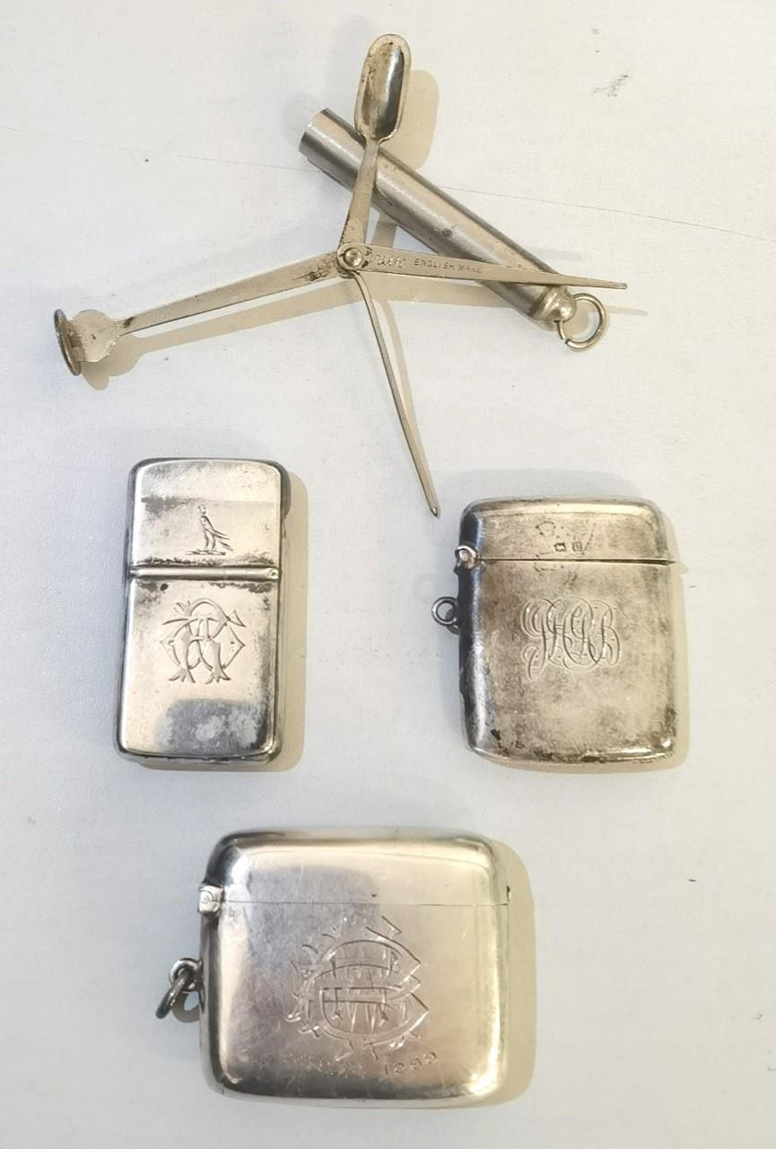 A group of three Victorian silver vesta cases having engraved motifs together with a Victorian