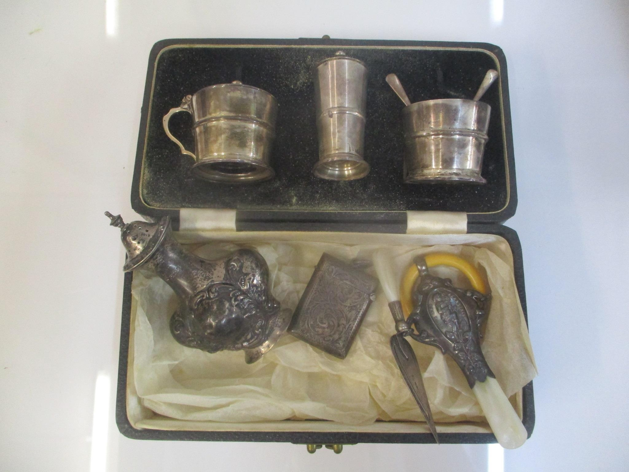 Silver to include a three piece condiment set, a baby rattle, a page marker, a vesta case and a