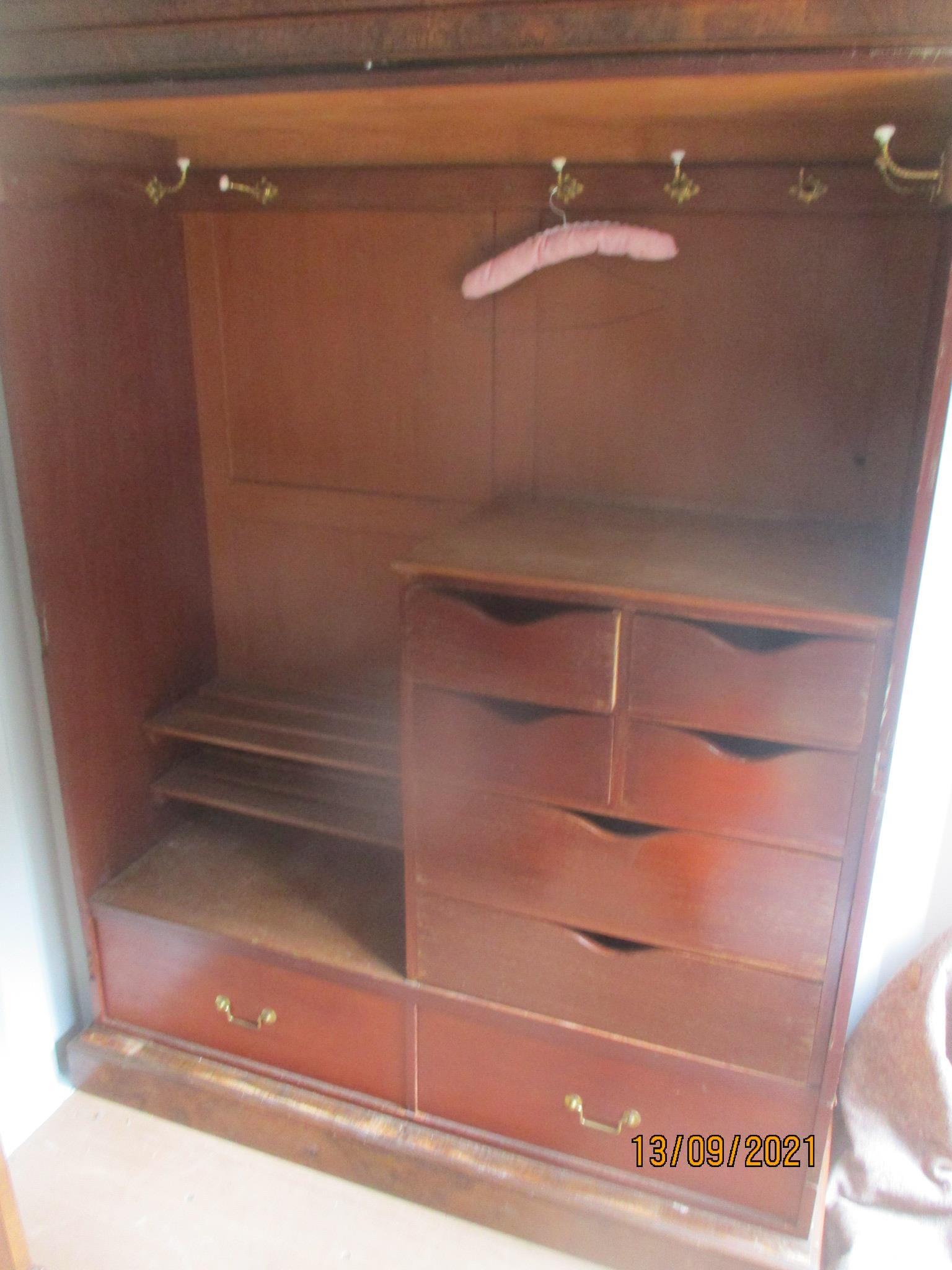 A Victorian burr walnut veneered two door wardrobe having two mirrored doors, revealing filled - Image 2 of 2