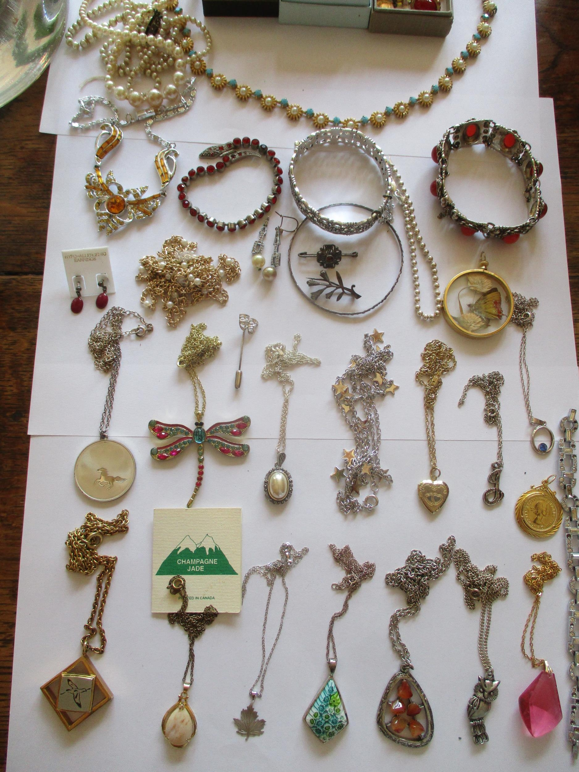 Mixed costume jewellery, mainly pendants on chains to include silver examples and a sterling