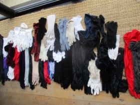 A large quantity of ladies gloves to include Dents, together with vintage scarves to include Ken