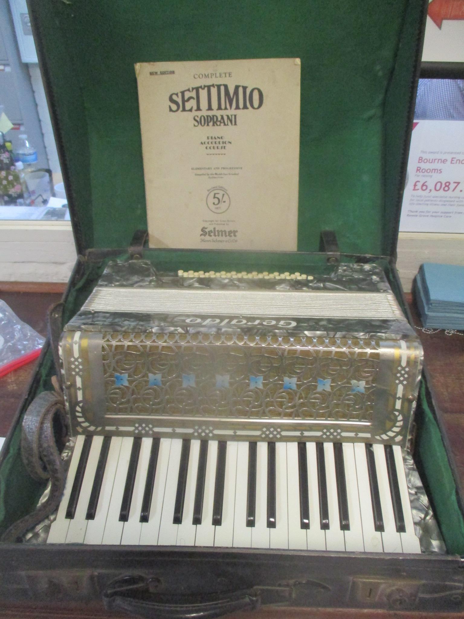 A Geraldo piano accordion in a case