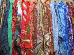 A large quantity of ladies scarves to include Jane Shilton, Planet, Jaeger, silk and hand rolled