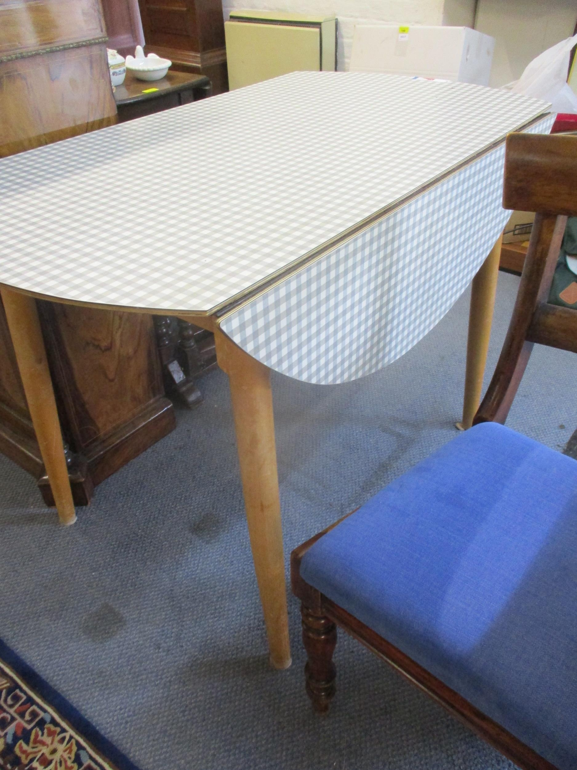 A vintage folding kitchen table with chequered Formica top above light wooden legs Location: RAM - Image 2 of 3