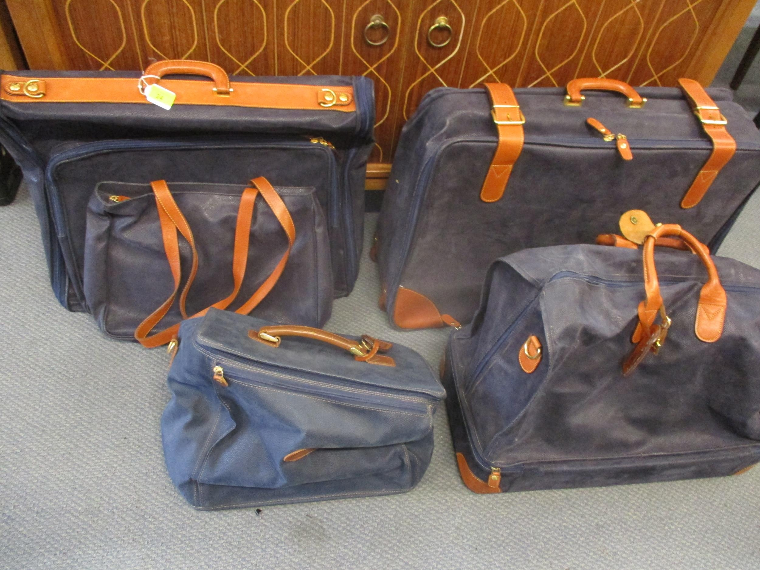 Five pieces of Italian Brics 'Lite' luggage items in a royal blue colour with brown leather straps