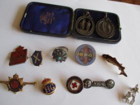 Vintage enamelled brooches and two rifle club pendants, together with a WVS civil defence pin badge,