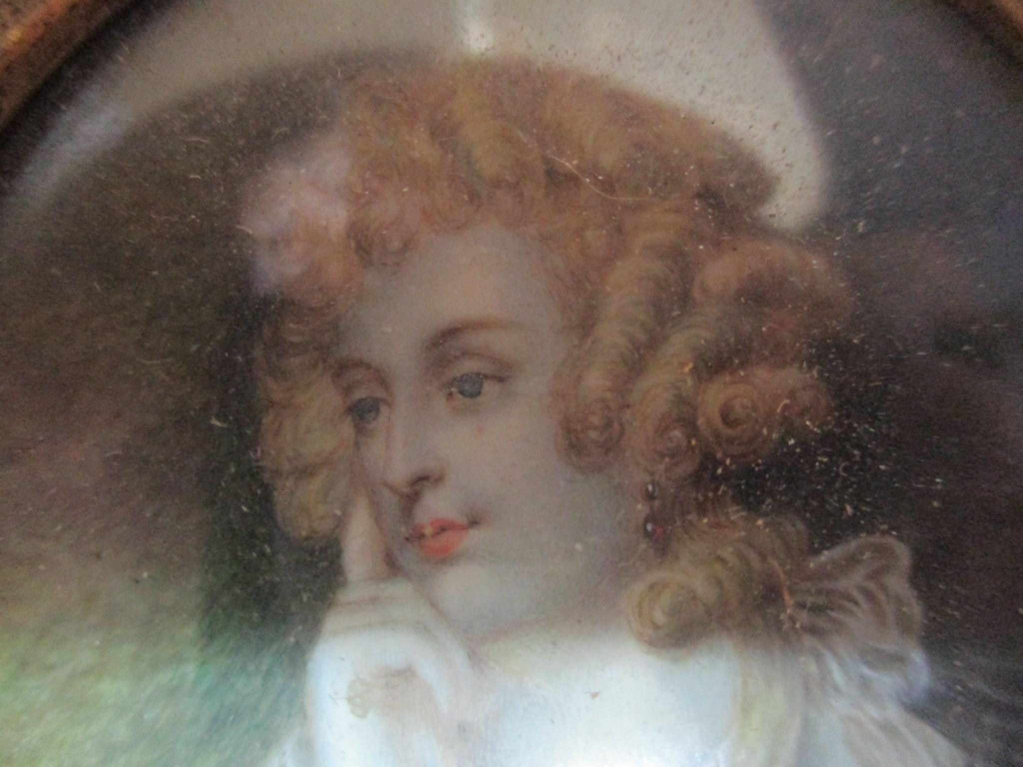 A miniature portrait paining of a young woman wearing red jewelled ear pendants, mounted in a 19th - Image 3 of 4