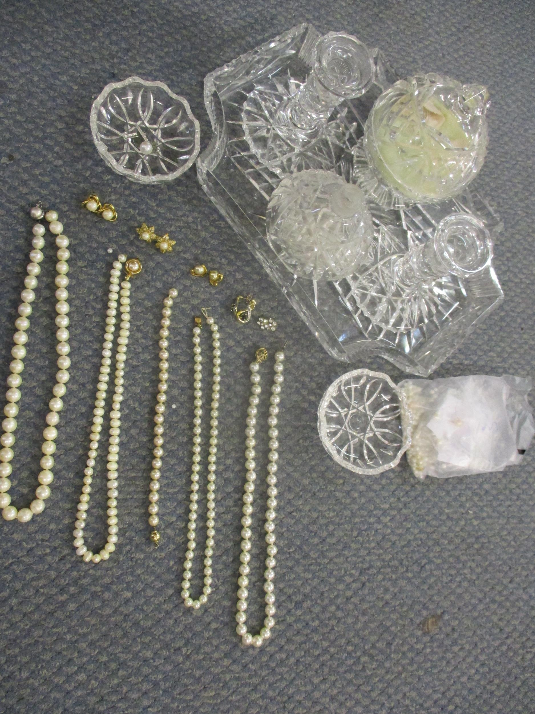 A 20th century cut glass dressing table set together with pearl and faux pearl costume jewellery