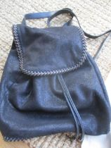 A Stella McCartney 2014 black sparkle suede effect 'Falabella Go' back-pack with silver tone