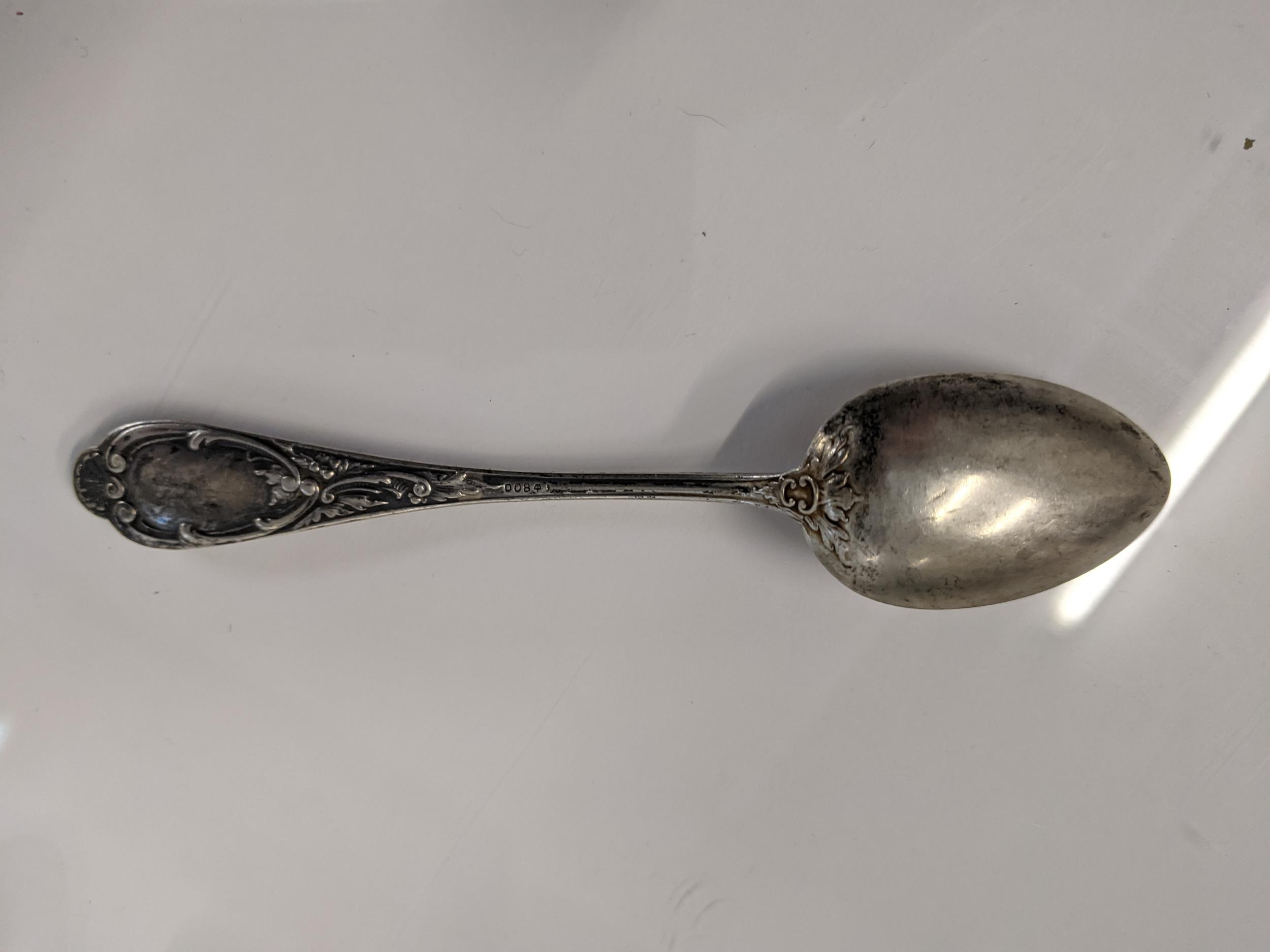 Silver and silver coloured metal to include seven teaspoons stamped 800, two sugar tongs and a - Image 2 of 2