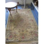 A Flemish Beluchi silk rug, 120 x 170cm together with a low pie crust walnut occasional table and an