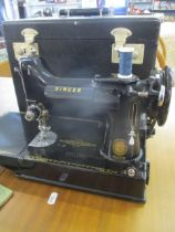 A 1950s Singer 221k electric sewing machine, serial number EL213218, with foot pedal, manuals and