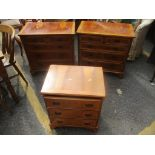 A pair of reproduction yew wood chests of drawers, 74 h x 74cm w, together with a matching smaller