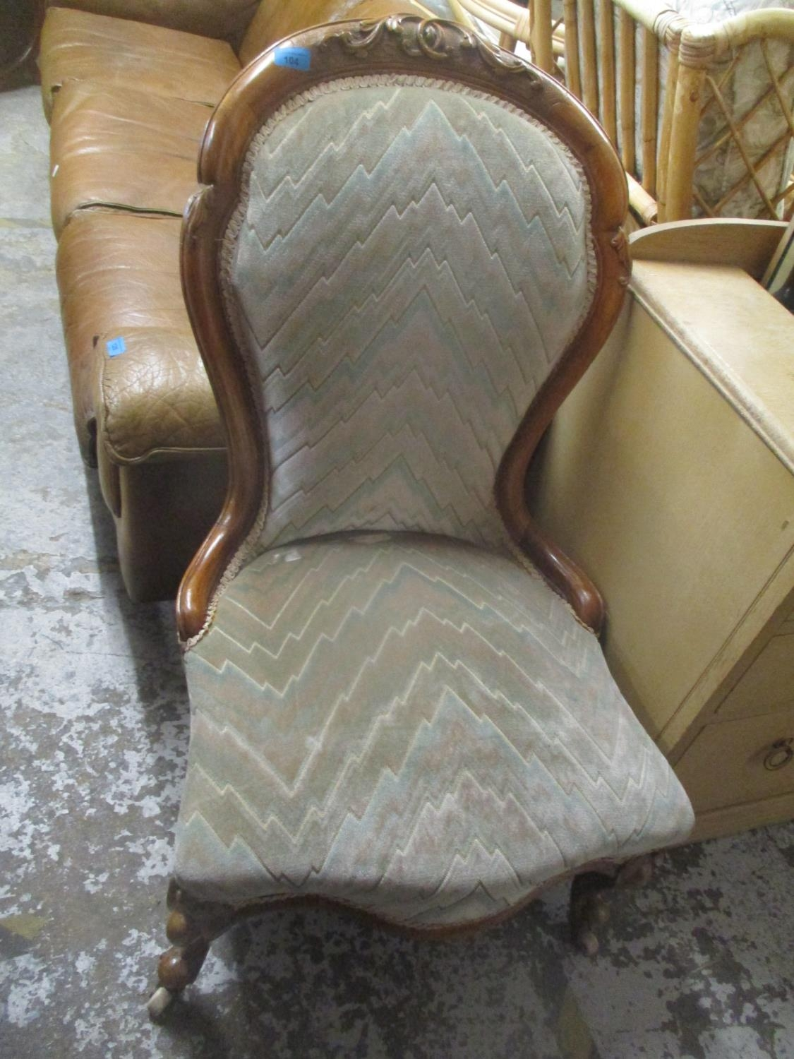 A Victorian walnut spoon back nursing chair on short cabriole front legs, an early 20th century