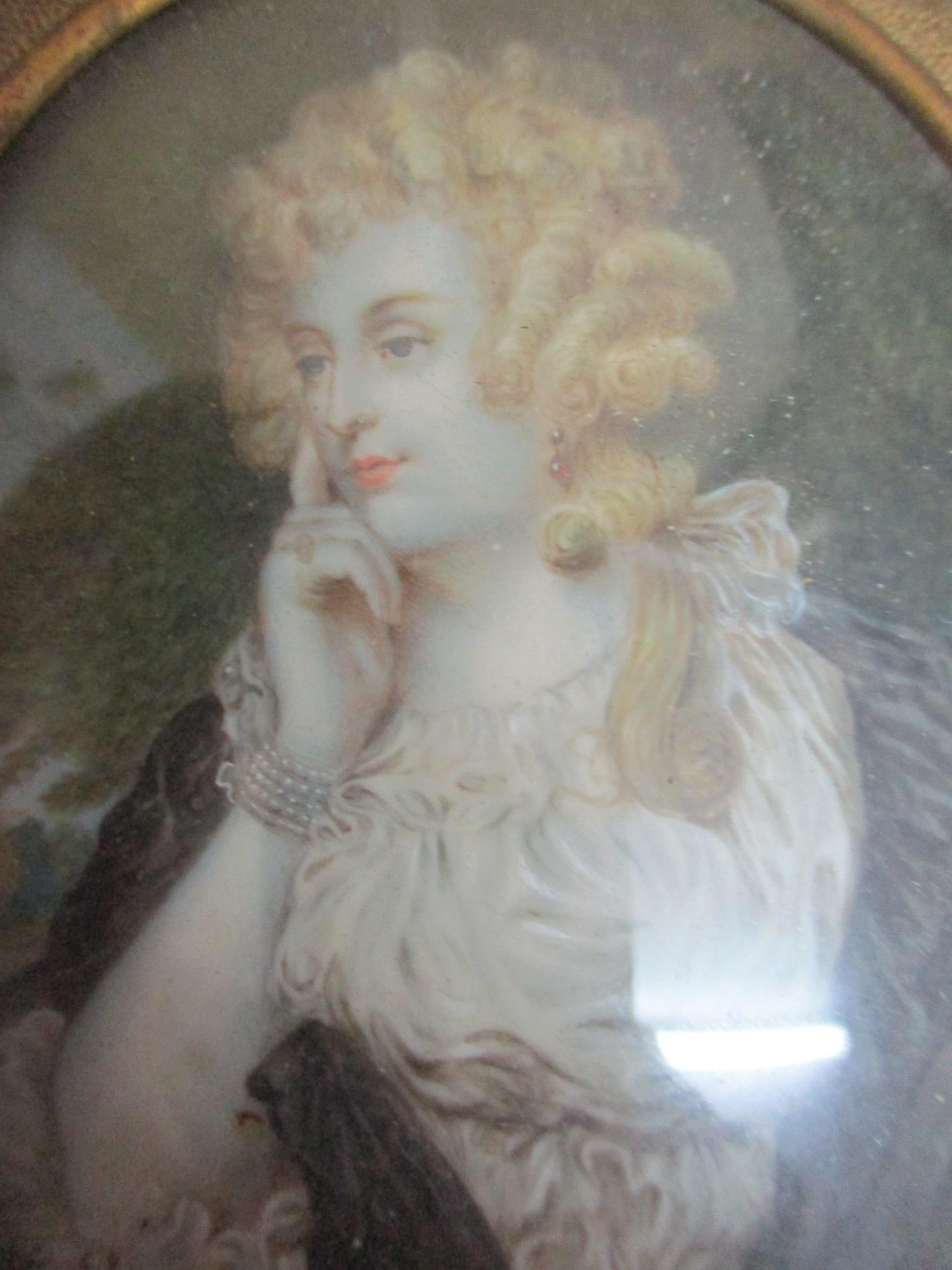 A miniature portrait paining of a young woman wearing red jewelled ear pendants, mounted in a 19th - Image 2 of 4