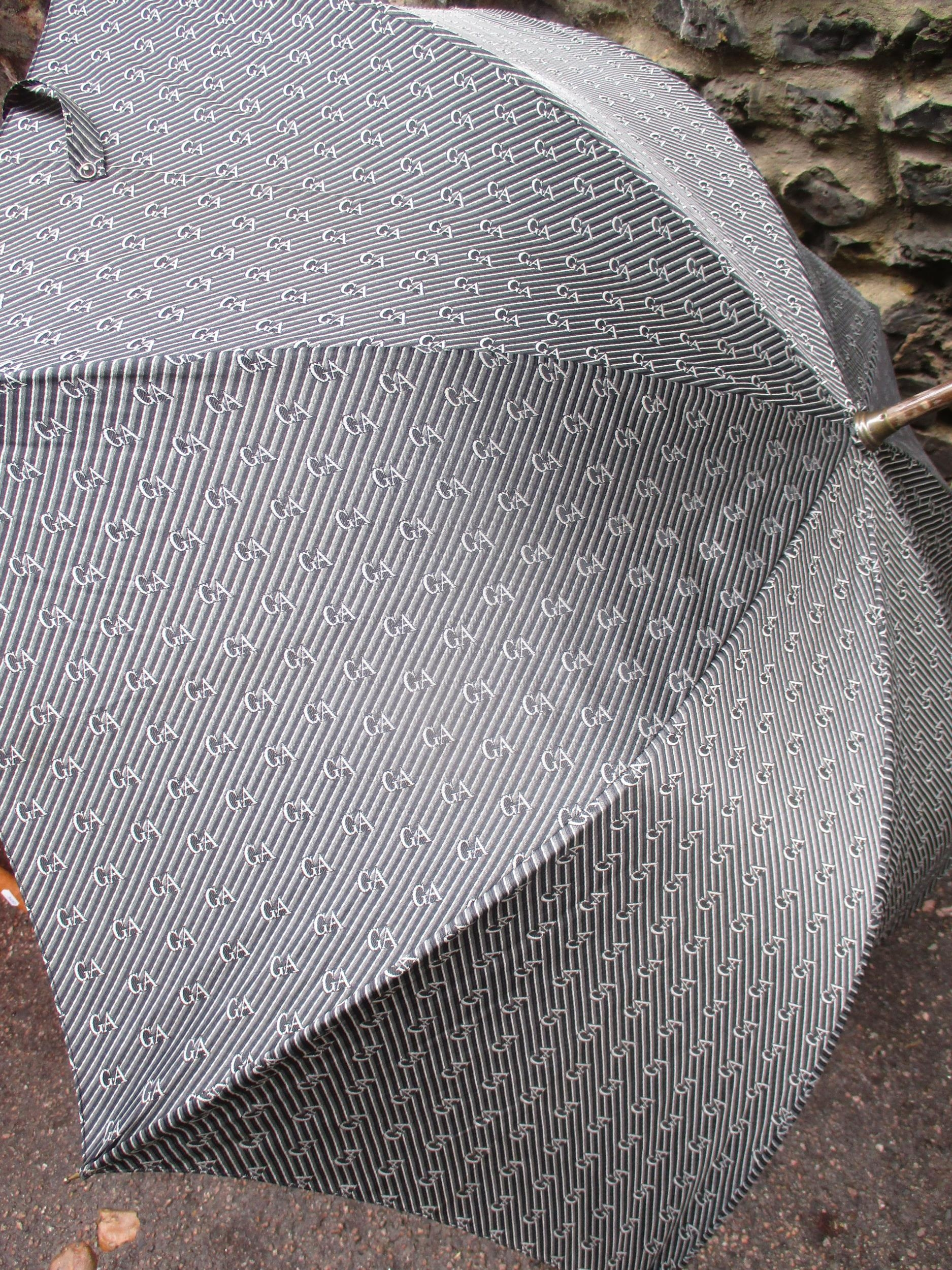 A Giorgio Armani branded umbrella and another by Charles Jourdan, together with a burnt orange - Image 5 of 5