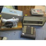 A Burroughs adding machine together with a Nord Mede radio, a Novum sewing machine and a WH Smith