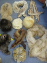 A quantity of vintage fur hats and stoles to include a lynx stole, a mink stole and red fox hats