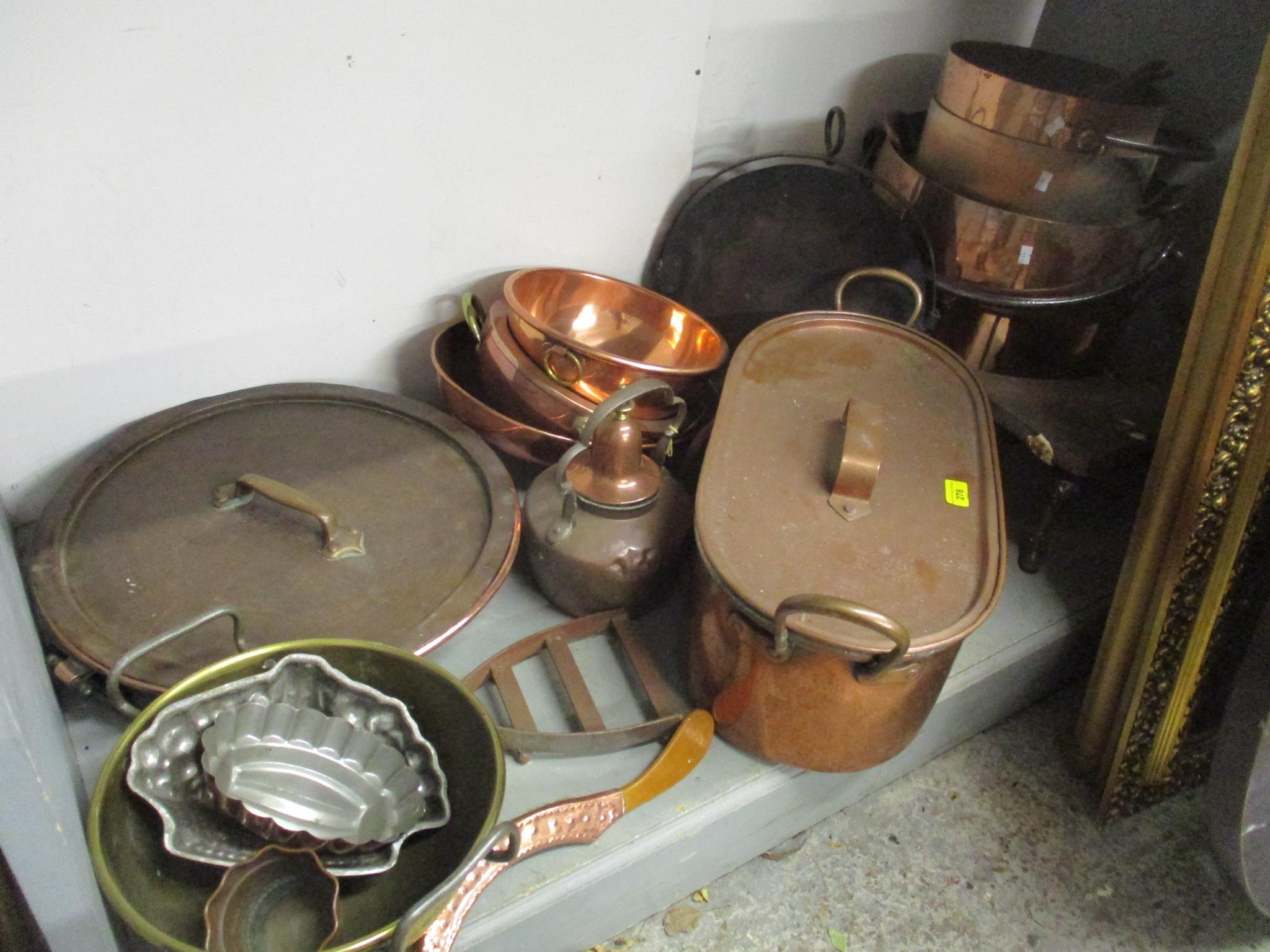 A good selection of copper and brassware to include graduated pans, jelly moulds, kettle, pots and