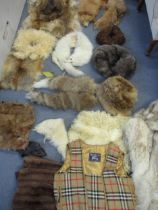A quantity of vintage fur hats, stoles, partial fur clothing (parts used for projects) and
