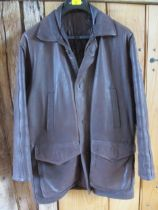 A gents Vera Pelle Italian leather brown leather over coat with two chest pockets and two deep front