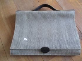 An Italian Nazareno Gabetteli black leather attache/laptop case having a black and brown chevron