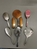 Eight silver dressing table brushes and mirrors Location: Port
