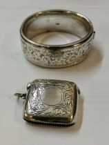 An early 20th century silver vesta case and a silver bangle Location: Cab