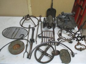 A quantity of metalware to include a cast iron foot scraper, and an iron model of a cannon Location: