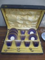 A Crescent china teaset decorated in gilt on a blue ground and a set of six silver gilt teaspoons,