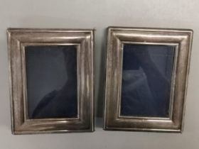 A pair of silver photo frames by Carrs of Sheffield, 18cm x 14cm Location: Port