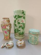 Three Oriental items to include a famille rose vase, a green glazed vase and a pot and cover A/F