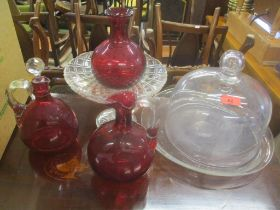 Glassware to include two Cranberry decanters, a vase, a cake basket, a cake stand