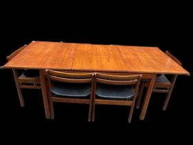A White & Newton 1960s teak extending dining table and six matching dining chairs, the dining