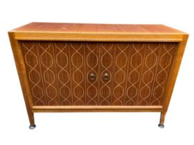 A Gordon Russell 1950s double helix sideboard designed by David Booth and Judith Ledeboer having two