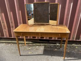 A Gordon Russell 1950s walnut and beech dressing table having a triptych mirror, central sliding