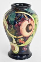 A Moorcroft vase in the Queens Choice pattern and of baluster form, dated 2000 to the base, 16 cm