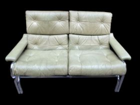 A 1960/70s Pieff Alpha sofa by Tim Bates, the leather and chrome sofa settee raised on tubular