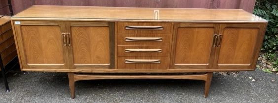 A mid 20th century G-Plan Fresco range teak sideboard, designed by Victor B Wilkins, with four
