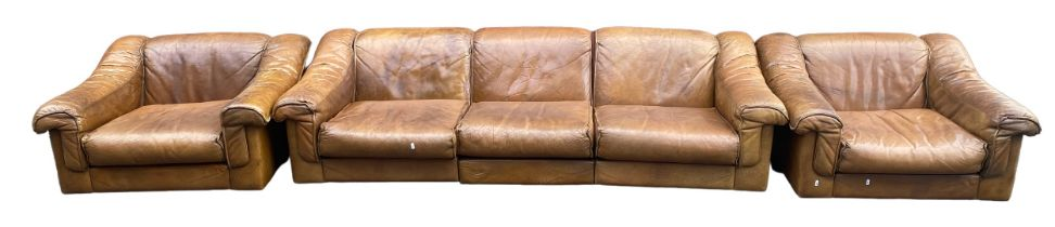 A mid 20th century retro leather suite by Vatne Mobler consisting of a three seater sofa and two
