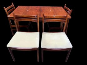 A mid 20th century Alexander Henry Mcintosh extending rosewood dining table and a set of four dining