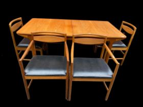 A mid 20th century Alexander Henry McIntosh teak extending dining table and four chairs, two being